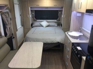 Eastern Caravan Hire caravan kitchen and bed